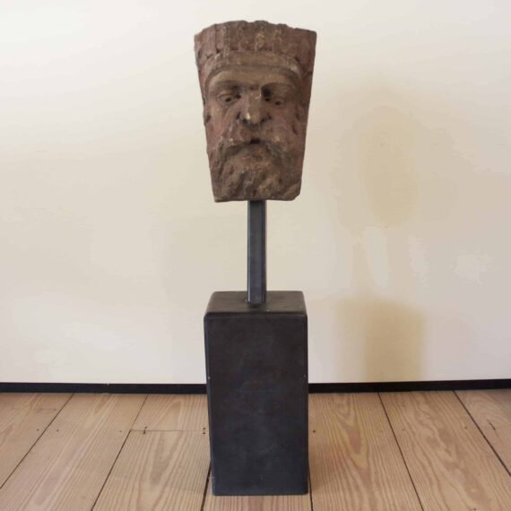 mounted stone carved head